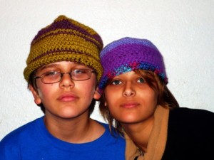 Brother kindly models sister's hat.